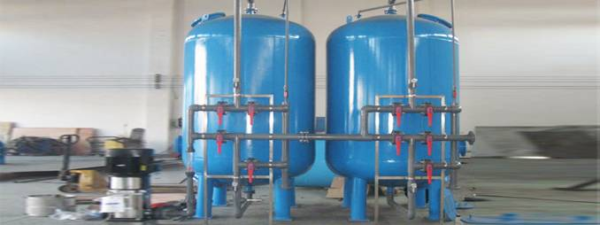 blue water treatment tanks with gray pipes