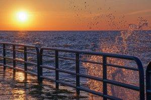 Beautiful sunset and water splashing off the north pier in St. Joseph