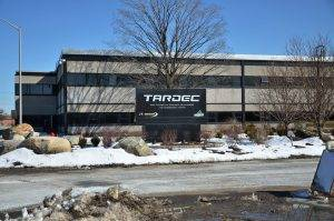 white and black building with TARDEC on the sign in front
